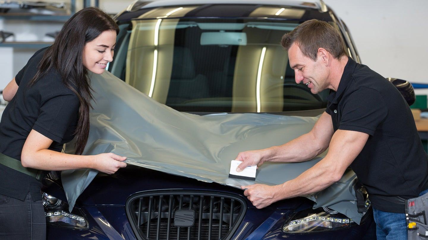 When wrapping a vehicle, it's best to use a helping hand.