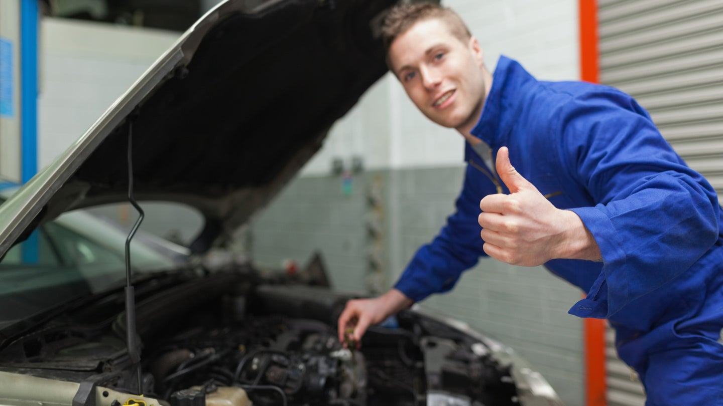 A mechanic tuning a car.