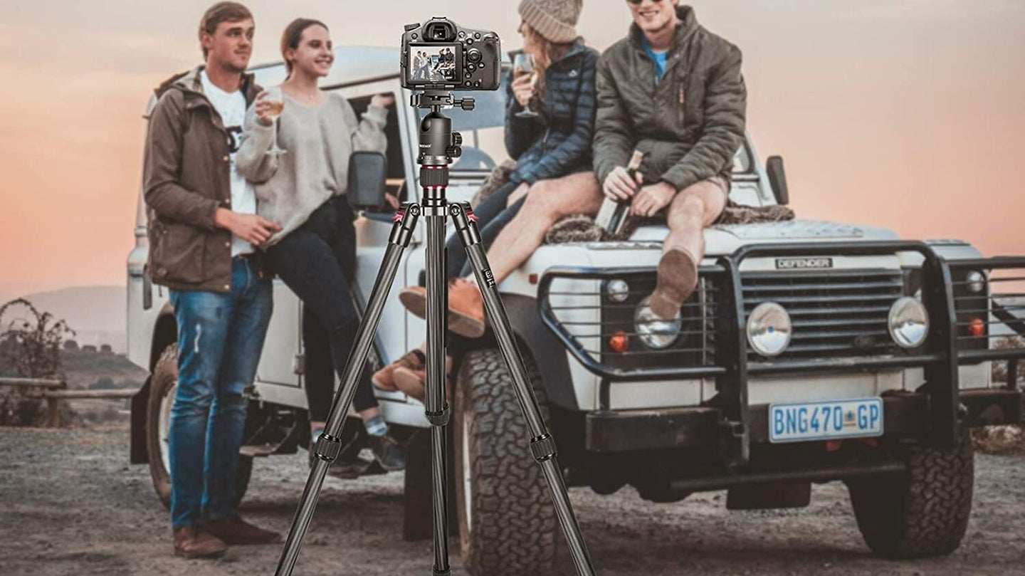 Carbon Fiber Tripod With Camera Taking Portrait Of Friends