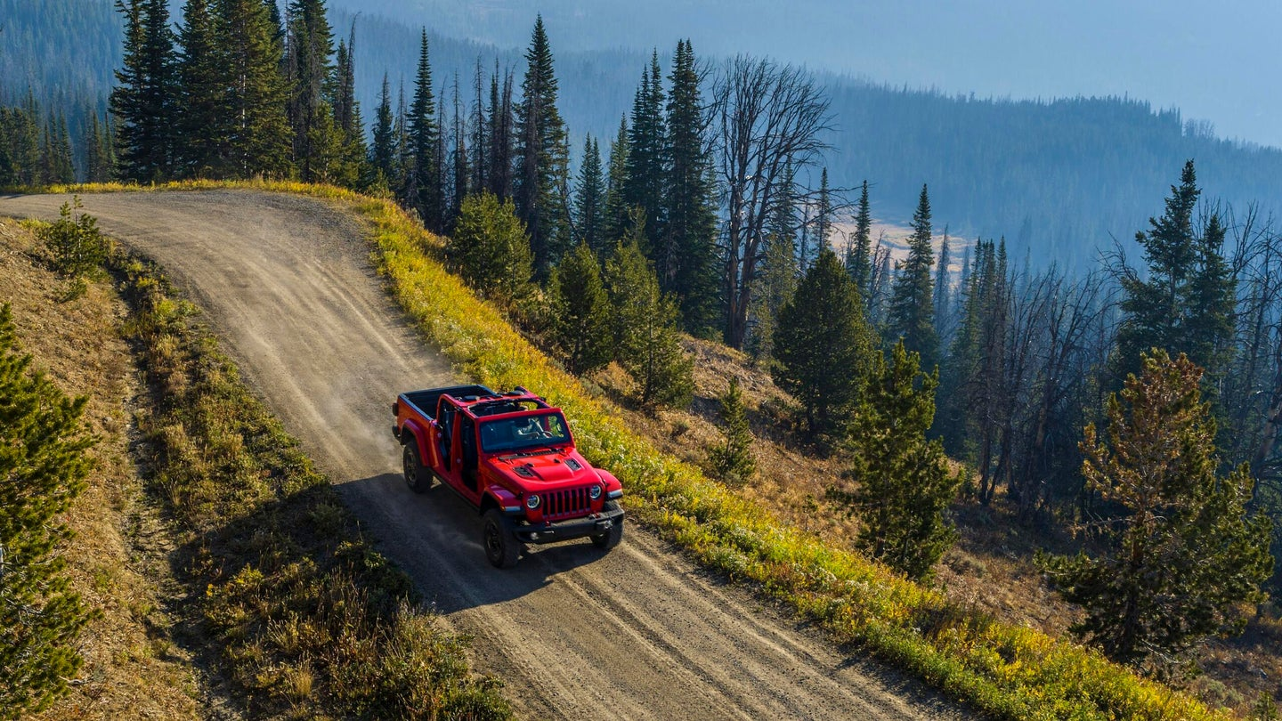 A 2021 Jeep Gladiator Rubicon drives down a mountain road.