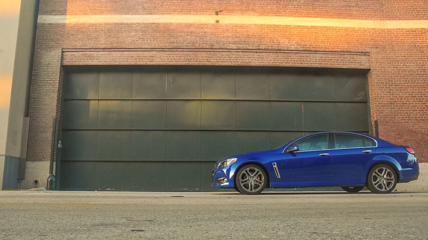A lone Chevrolet SS sits in front of a garage.