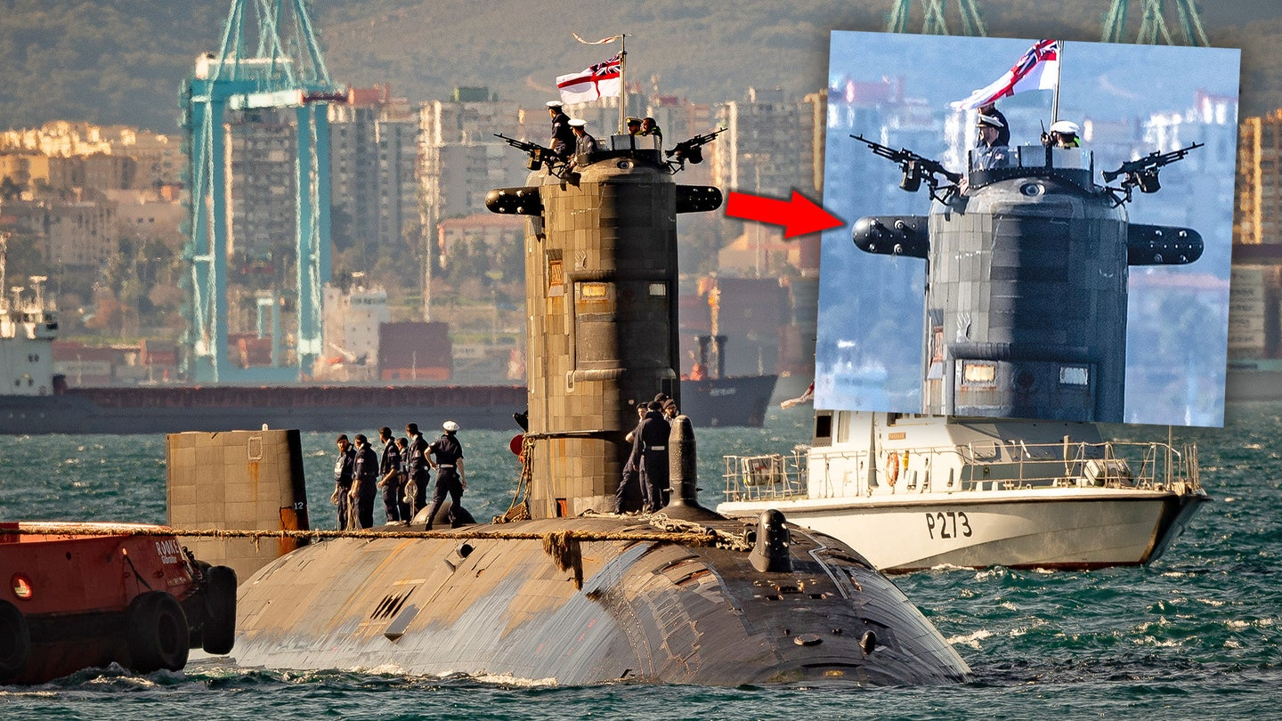 Pictures of HMS Talent showing two new sensor arrays on either side of its sail.