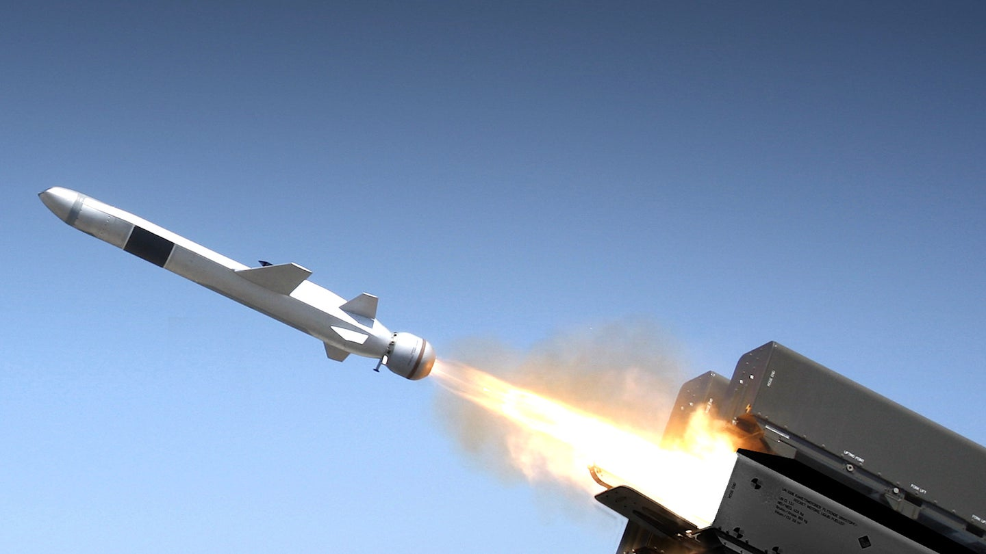 A Naval Strike Missile flies from a ground-based launcher.