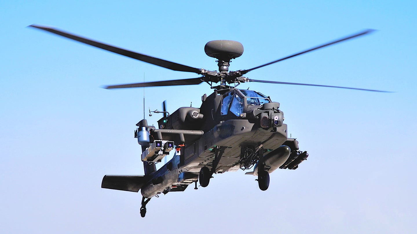 An AH-64E armed with Spike-NLOS missiles during testing in February 2021.