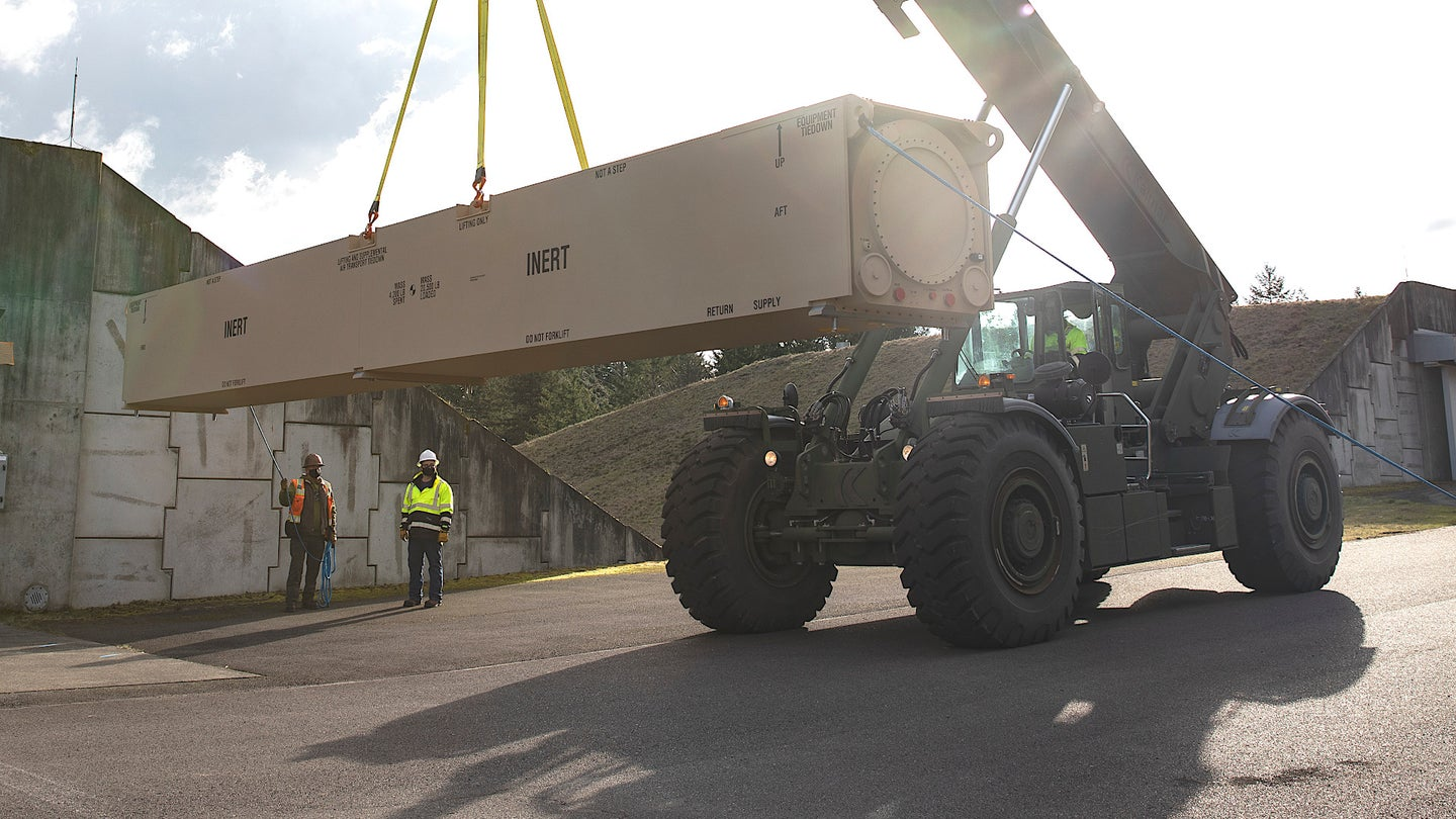 A forklift moves one of two training canisters for the Army's Long Range Hypersonic Weapon system after their delivery in March 2021.
