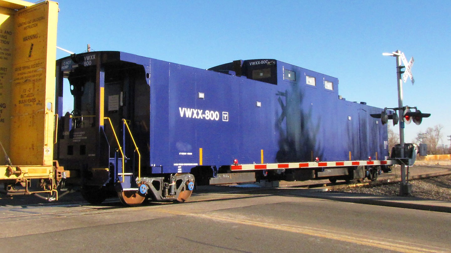 An armored caboose designed to be an escort car to guard trains carrying sensitive nuclear cargoes.