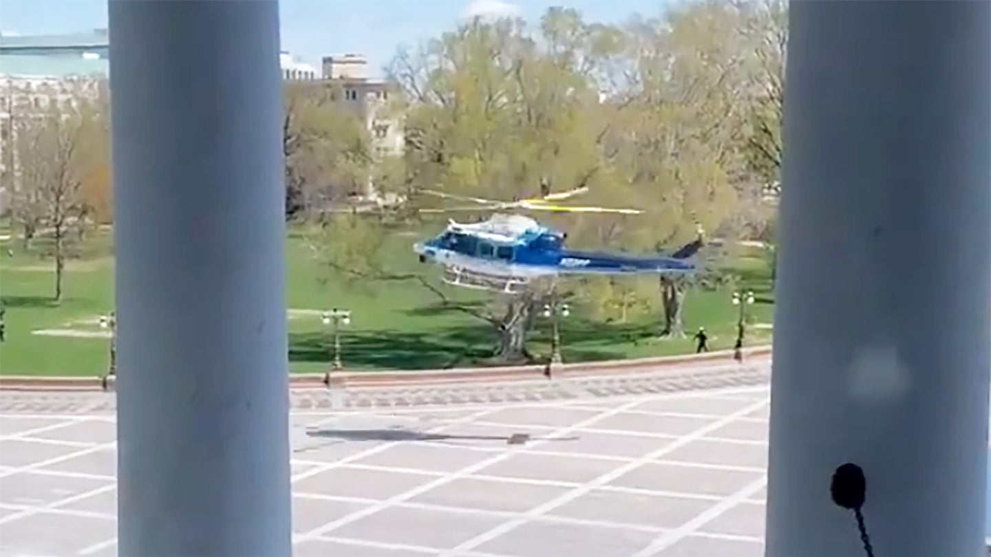 A screen capture from a video showing the US Park Police Bell 412 helicopter landing outside of the US Capitol building.