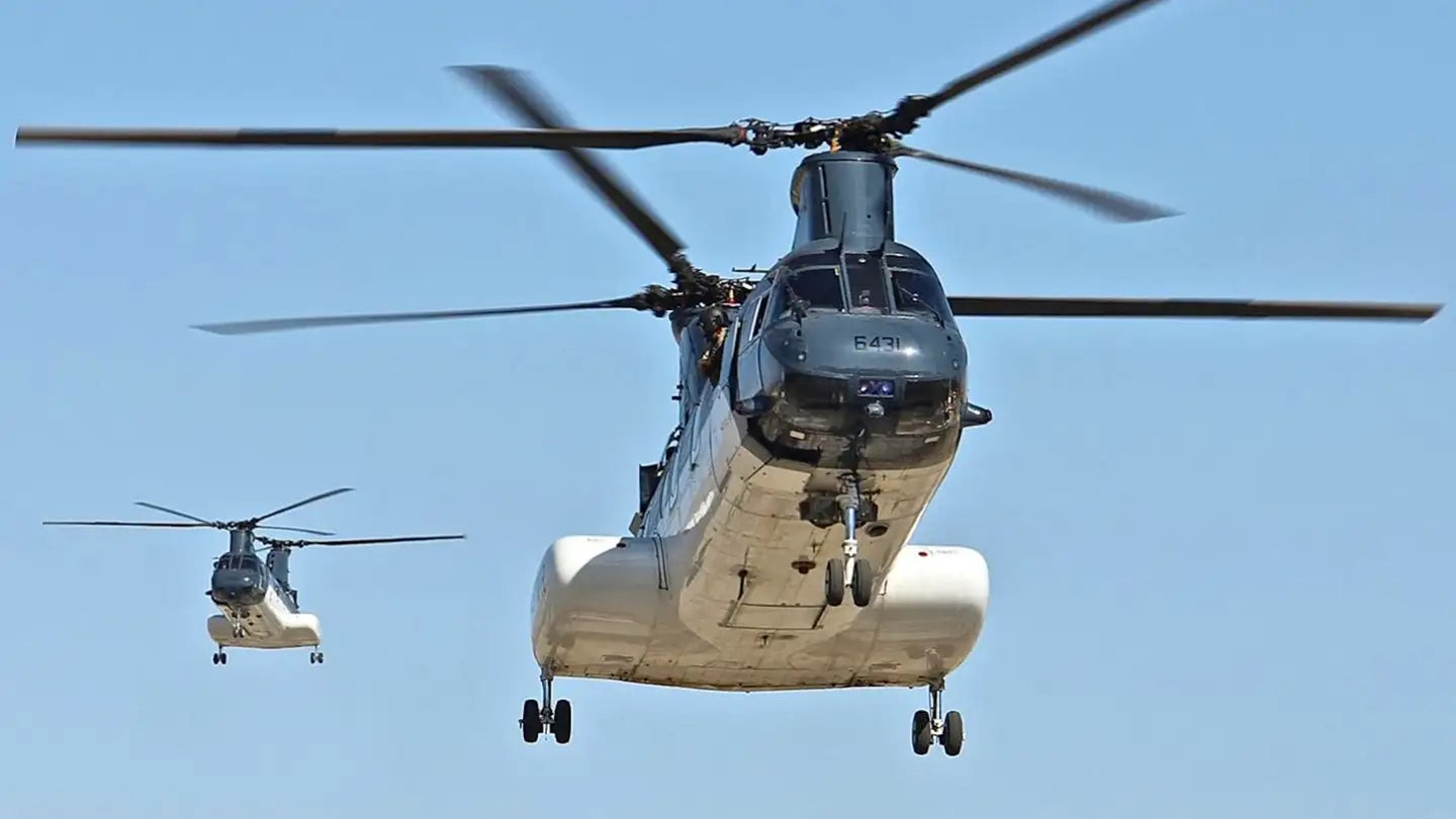 A pair of US State Department CH-46E Sea Knight helicopters, or Phrogs.