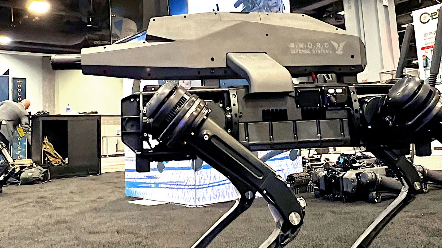 A Ghost Robotics Q-UGV unmanned system with a Special Purpose Unmanned Rifle module on top.